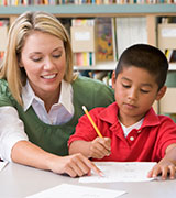 Beginning Teachers Series teacher helping student with assignment